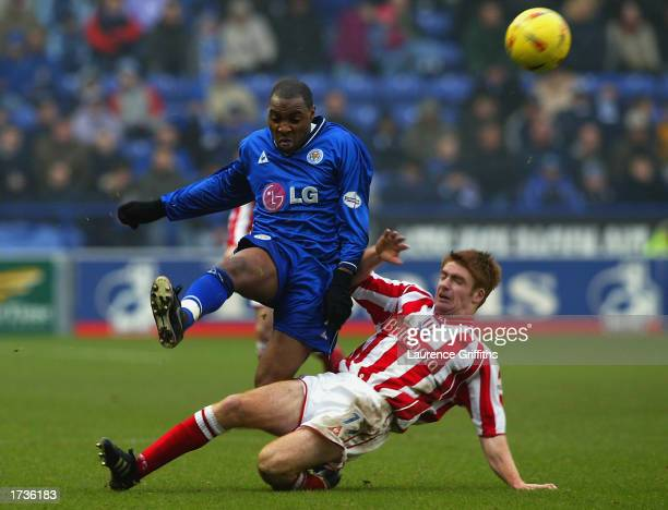 Andrew Impey of Leicester City clears the ball as James O'Connor of Stoke City comes sliding in to make a challenge during the Nationwide League...