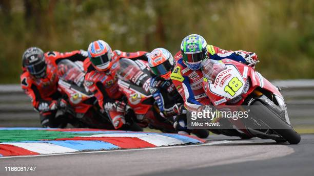 Andrew Irwin of Northern Ireland on his way to victory in the first race of the British Superbikes Championships at Thruxton Circuit on August 04,...