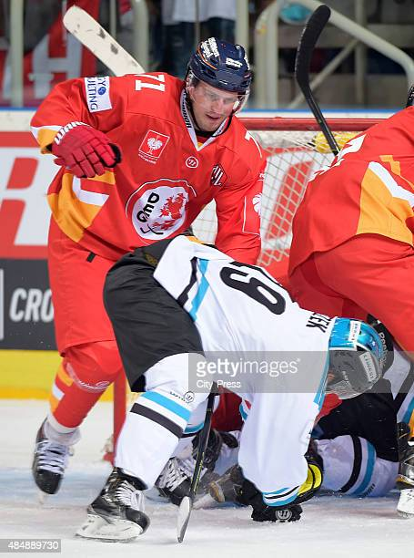 Andrew Jacob Kozek of the Black Wings Linz and Travis Turnbull of the Duesseldorfer EG fight for the puck during the game between Duesseldorfer EG...