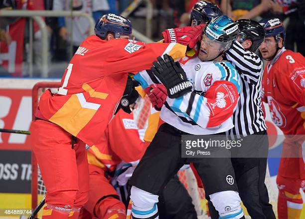 Andrew Jacob Kozek of the Black Wings Linz and Travis Turnbull of the Duesseldorfer EG have a fight during the game between Duesseldorfer EG and...