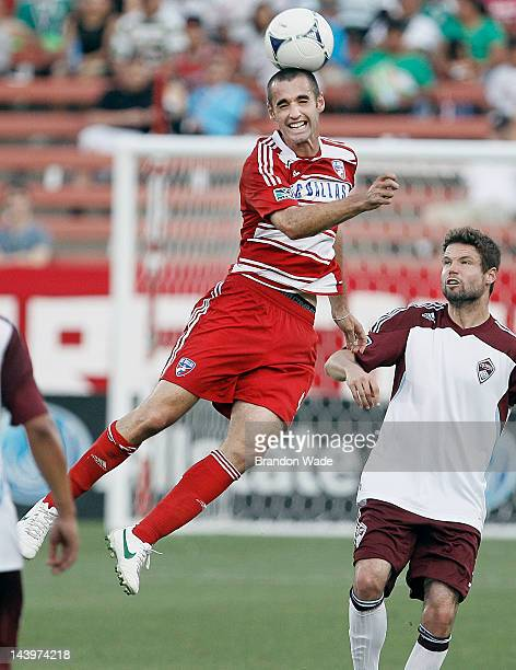 Andrew Jacobson of the FC Dallas heads the ball as Drew Moor of the Colorado Rapids looks on during the second half of a soccer game at FC Dallas...