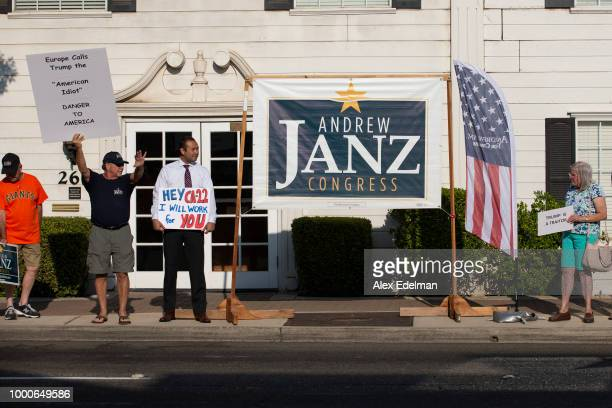 A woman takes a photo as Fresno County Assistant District Attorney Andrew Janz speaks during a meet and greet at his home on July 17 2018 in Fresno...
