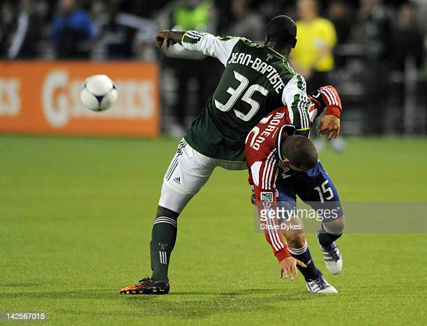 Andrew JeanBaptiste of the Portland Timbers grabs a hold of Alejandro Moreno of the Chivas USA during the second half of the game at JeldWen Field on...