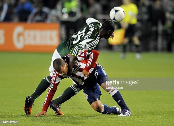 Andrew JeanBaptiste of the Portland Timbers grabs a hold of Alejandro Moreno of Chivas USA during the second half of the game at JeldWen Field on...