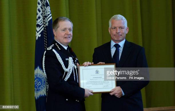 Andrew Jenkins from South Wales receives his award from Met Police Commissioner Sir Ian Blair at the Metropolitan Police Service Commissioner...