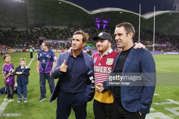 Andrew Johns and Brad Fittler pose with a Broncos fan during the round one NRL match between the Melbourne Storm and the Brisbane Broncos at AAMI...
