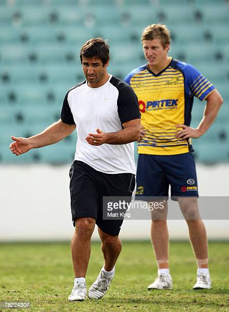 Andrew Johns demonstrates a move as Brett Finch of the Eels looks on during a Parramatta Eels training session at Parramatta Stadium on December 4,...