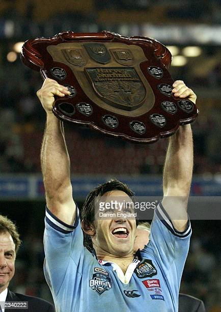 Andrew Johns of the Blues holds aloft the shield after winning the series after game three of the NRL State of Origin Series between the Queensland...