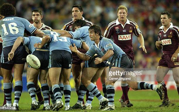 Andrew Johns of the Blues passes the ball out of the scrum during game three of the NRL State of Origin Series between the Queensland Maroons and the...
