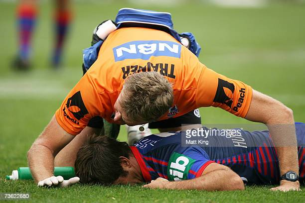 Andrew Johns of the Knights lies motionless and is attended to by medical staff after a high shot from Sonny Bill Williams of the Bulldogs during the...