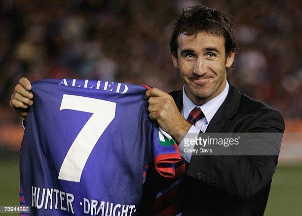 Andrew Johns of the Knights receives the no 7 jersey which will be retired for the round six NRL match between the Newcastle Knights and the Brisbane...