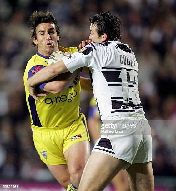 Andrew Johns of Warrington hands off Paul Cooke of Hull during the Engage Super League match between Hull FC and Warrington Wolves at the KC Stadium...