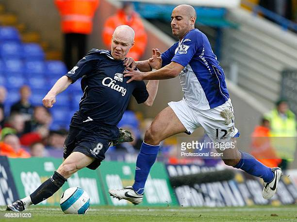 Andrew Johnson of Everton is tackled by Mehdi Nafti of Birmingham City during the Barclays Premier League match between Birmingham City and Everton...