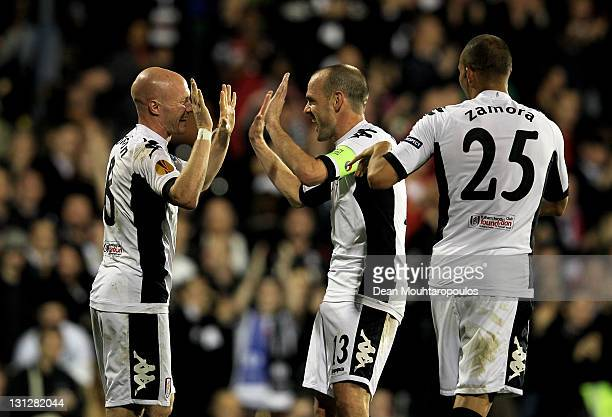 Andrew Johnson of Fulham celebrates with teammates Danny Murphy and Bobby Zamora after scoring his team's third goal during the UEFA Europa League...