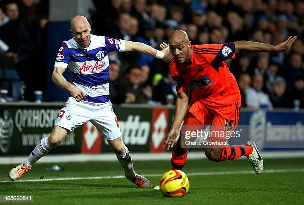 Andrew Johnson of QPR is pushed off the ball by Bolton's Alex Baptiste during the Sky Bet Championship match between Queens Park Rangers and Bolton...