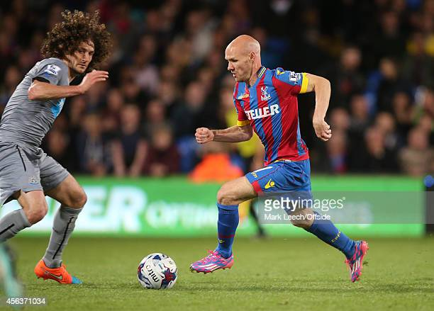 Andrew Johnson takes the ball past Fabricio Coloccini of Newcastle during the Capital One Cup Third Round between Crystal Palace and Newcastle United...
