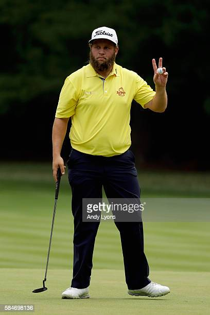 Andrew Johnston of England acknowledges the crowd after making a putt for par on the second hole during the third round of the 2016 PGA Championship...