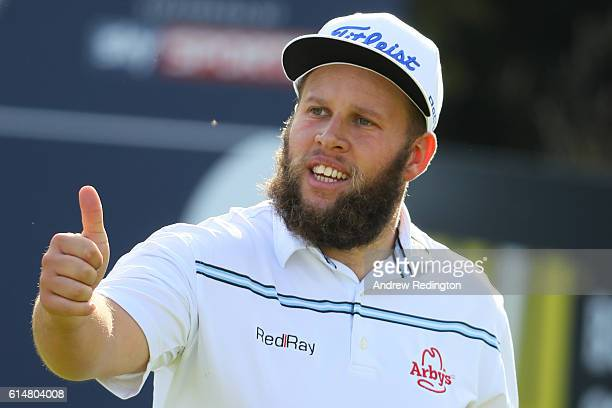 Andrew Johnston of England acknowledges the crowd on the ninth green during the third round of the British Masters at The Grove on October 15 2016 in...
