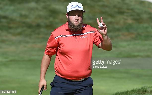 Andrew Johnston of England acknowledges the gallery after sinking a putt on the 15th hole during the final round of the Albertsons Boise Open at...