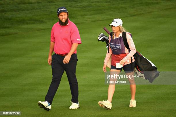 Andrew Johnston of England and his caddie walk down hole ten during Day Two of the Omega Dubai Desert Classic at Emirates Golf Club on January 25...