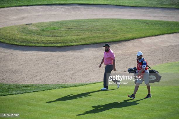 Andrew Johnston of England and his caddie walk on the 18th hole during round three of the Abu Dhabi HSBC Golf Championship at Abu Dhabi Golf Club on...