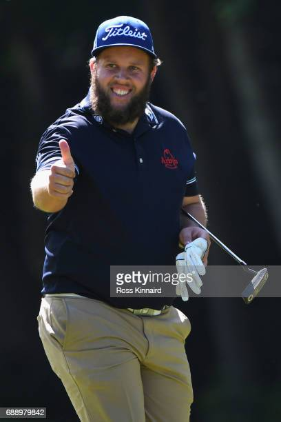 Andrew Johnston of England gives a thumbs up to the crowd on the 16th hole during day three of the BMW PGA Championship at Wentworth on May 27 2017...