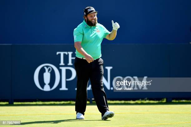Andrew Johnston of England gives a thumbs up to the crowd on the 1st hole during a practice round prior to the 146th Open Championship at Royal...