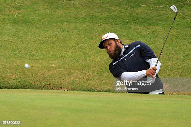 Andrew Johnston of England hits a bunker shot on the 8th during the final round on day four of the 145th Open Championship at Royal Troon on July 17...