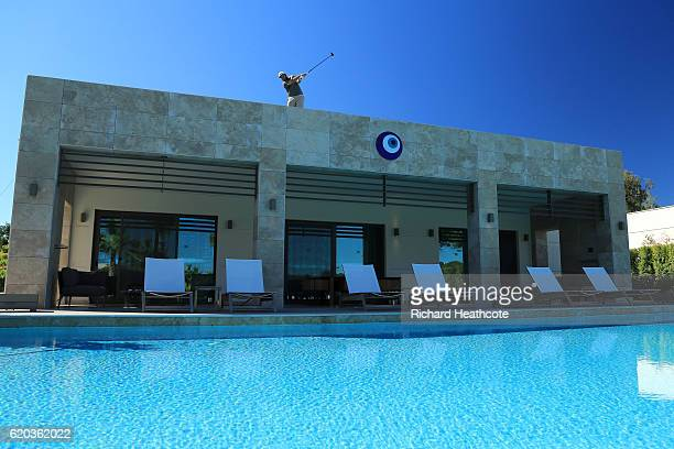 Andrew Johnston of England hits a shot from the 16th tee which is on top of a villa during a practice round for the Turkish Airlines Open at the...