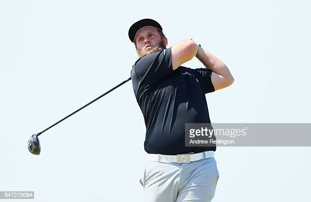 Andrew Johnston of England hits hi stee shot on the sixth hole during the first round on day one of the 145th Open Championship at Royal Troon on...