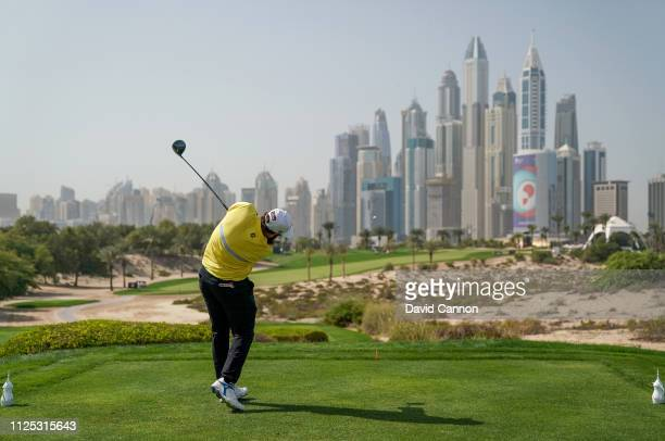 Andrew Johnston of England hits his a tee shot on the eighth hole during the final round of the Omega Dubai Desert Classic on the Majlis Course at...