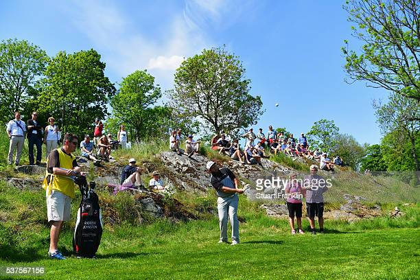 Andrew Johnston of England is watched by spectators as he plays a shot on the 9th hole during the first round on day one of the Nordea Masters at Bro...