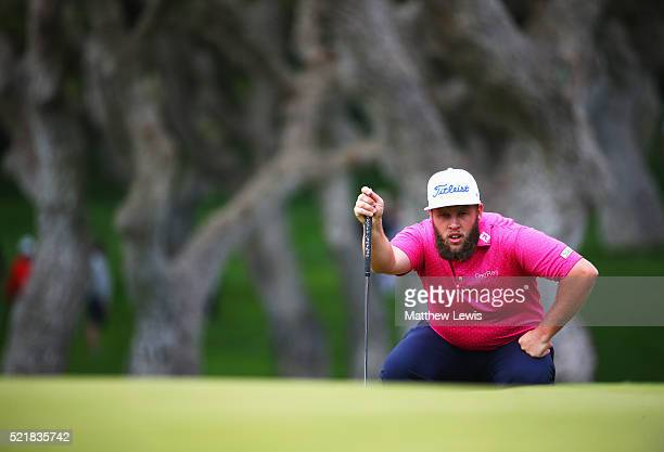 Andrew Johnston of England lines up a putt on the 18th green during the final round on day four of the Open de Espana at Real Club Valderrama on...