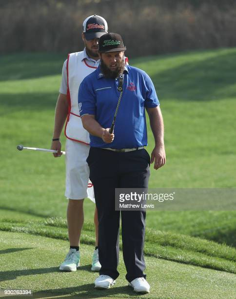 Andrew Johnston of England lines up a putt with his caddie during day four of the Hero Indian Open at Dlf Golf and Country Club on March 11 2018 in...