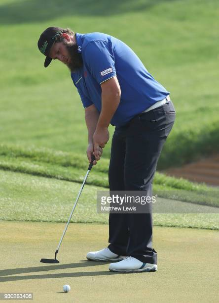 Andrew Johnston of England makes a putt with his caddie during day four of the Hero Indian Open at Dlf Golf and Country Club on March 11 2018 in New...