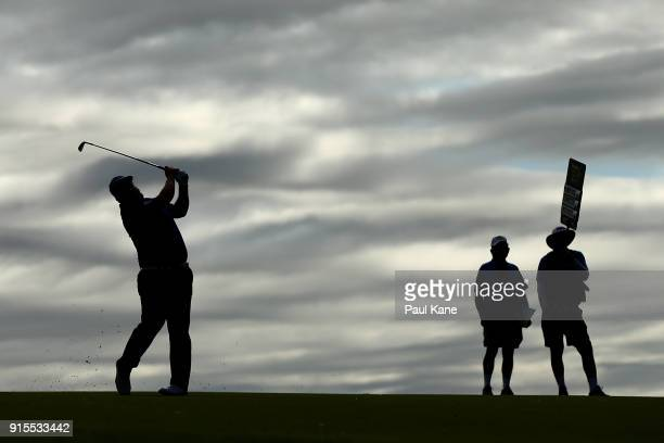 Andrew Johnston of England plays his approach shot on the 18th hole during day one of the World Super 6 at Lake Karrinyup Country Club on February 8...