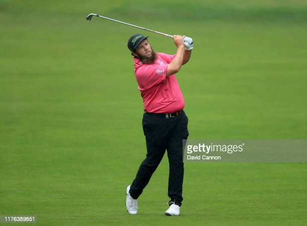 Andrew Johnston of England plays his second shot on the 12th hole during the final round of the BMW PGA Championship on the West Course at the...