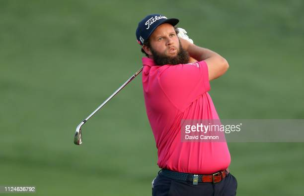 Andrew Johnston of England plays his second shot on the par 5 10th hole during the second round of the Omega Dubai Desert Classic on the Majlis...