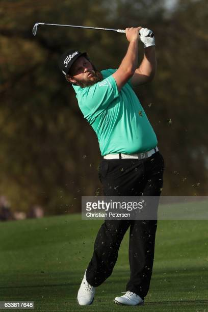 Andrew Johnston of England plays his second shot on the second hole during the first round of the Waste Management Phoenix Open at TPC Scottsdale on...
