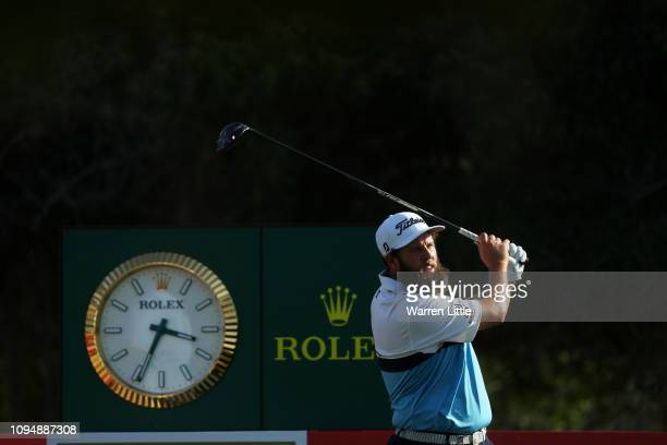 Andrew Johnston of England plays his shot from the 16th tee during Day One of the Abu Dhabi HSBC Golf Championship at Abu Dhabi Golf Club on January...