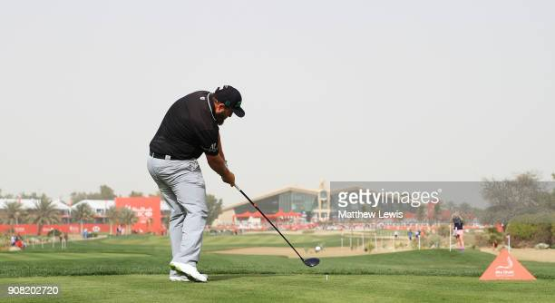 Andrew Johnston of England plays his shot from the ninth tee during the final round of the Abu Dhabi HSBC Golf Championship at Abu Dhabi Golf Club on...