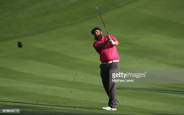 Andrew Johnston of England plays his third shot from the 15th fairway during day two of the Hero Indian Open at Dlf Golf and Country Club on March 9...
