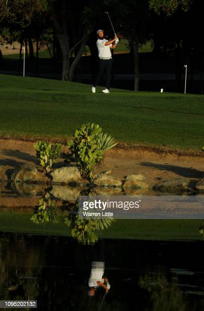 Andrew Johnston of England plays his third shot on the 12th hole during Day Two of the Abu Dhabi HSBC Golf Championship at Abu Dhabi Golf Club on...