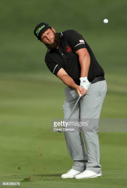 Andrew Johnston of England plays his third shot on the 16th hole during the final round of the Abu Dhabi HSBC Golf Championship at Abu Dhabi Golf...