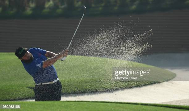 Andrew Johnston of england plays out of a bunker on the 1st hole during day four of the Hero Indian Open at Dlf Golf and Country Club on March 11...