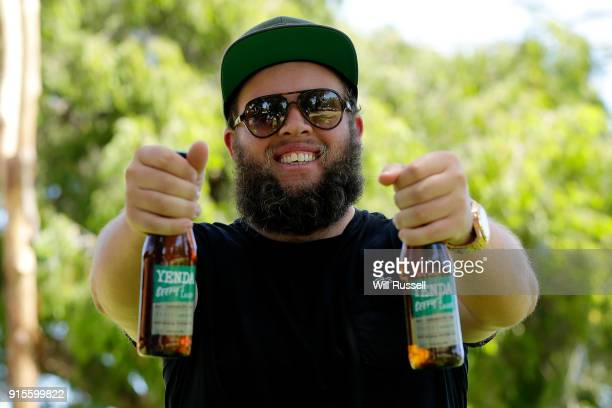 Andrew Johnston of England poses with a special edition Beefy's Lager by Yenda during day one of the World Super 6 at Lake Karrinyup Country Club on...