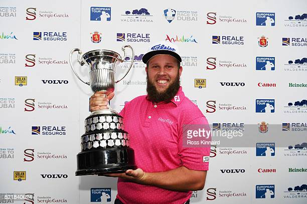 Andrew Johnston of England poses with the trophy after victory during the final round on day four of the Open de Espana at Real Club Valderrama on...
