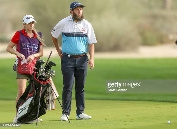 Andrew Johnston of England prepares to play his second shot on the 16th hole with his caddy fiancee Jodi Valencia during the first round of the Omega...