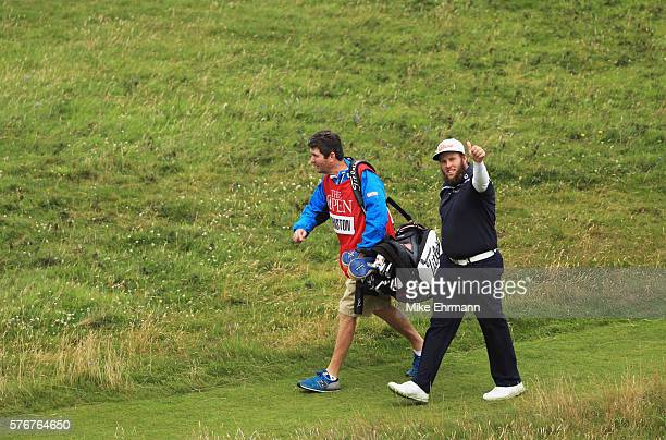 Andrew Johnston of England salutes the crowds as he walks on the 8th hole during the final round on day four of the 145th Open Championship at Royal...