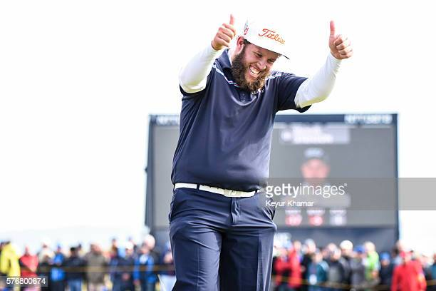 Andrew Johnston of England smiles and gives a thumbs up to fans on the 16th hole tee box during the final round on day four of the 145th Open...